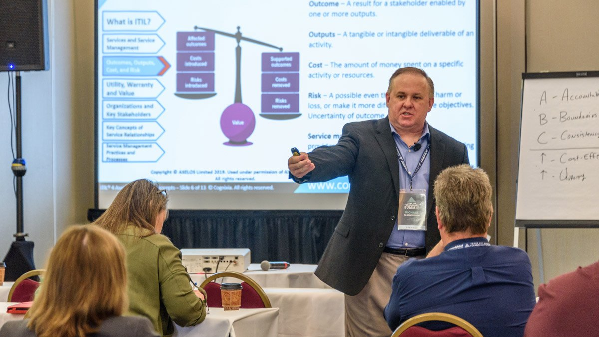 A man presents ITIL principles at a breakout session at Tech Summit.